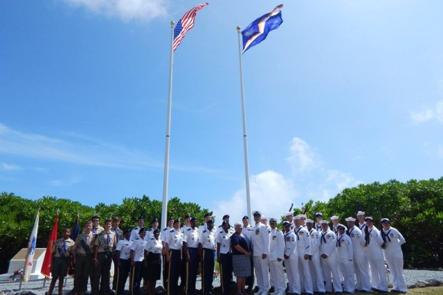 Soldiers and Sailors serving on U.S. Army Garrison Kwajalein Atoll gathered with representatives from the U.S. Embassy and local Boy Scouts to honor the sacrifices made by veterans who came before them, Nov. 11, 2015