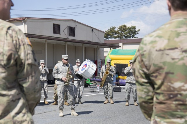 """U.S. Army Japan Band provides entertainment during the Camp Zama Red Cross Barbecue held March 15, in honor of Red Cross Month and in remembrance for the fifth anniversary of the """"Great East Japan Earthquake and Tsunami,"""" which cause catastrophic damage to Japan's eastern coast on March 11, 2011.  (U.S. Army photo by Alia Naffouj)"""