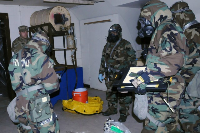 U.S. and Republic of Korea Soldiers conducted  quaterly training with the 23rd Chemical Battalion, 2nd Infantry Division, while being evaluated by the observer controllers to make sure sampling procedures are done properly. They tested 55-gallon drums with florescent liquid on Camp Mobile, Republic of Korea, March 15.