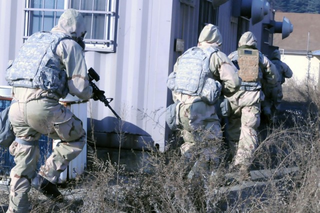 Infantry platoons conduct  a Chemical Biological Radilogical Nuclear and Explosive Combine Exploitation Evaluation (ExEval) quarterly training with the 23rd Chemical Battalion, 2nd Infantry Division. The platoons cleared  building looking for any improvised explosive devices, hazards and enemy personnel at Camp Mobile, Republic of Korea, March 15.