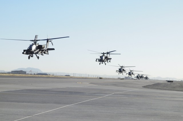 Eight AH-64 Apache Helicopters from 1st Armored Division lift off from Biggs Army Airfield at Fort Bliss, TX Feb. 27.