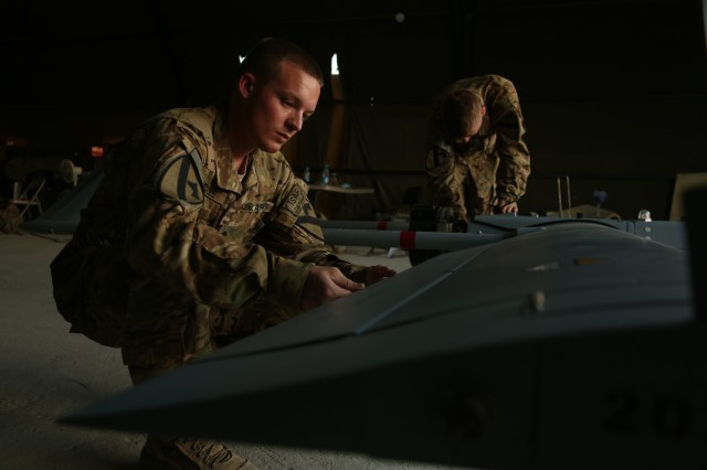 Spc. Kevin McGee, an Unmanned Aerial System maintainer with 4th Brigade Special Troops Battalion, 4th Brigade Combat Team, 1st Cavalry Division, conducts a functions check on an UAS on Combat Outpost Xia Haq, Afghanistan, May 31, 2013. Function checks are conducted prior to every take off for accurate performance.