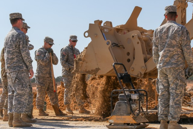 Engineers assigned to the 307th Brigade Engineer Battalion, 3rd Brigade Combat Team, 82nd Airborne Division, fill a sand grid-lined crater with soil during airfield damage repair (ADR) training on Fort Bragg, N.C., March 8, 2016. For the past three weeks, U.S. joint military and civilian engineers teamed up at Sicily Drop Zone on Fort Bragg, N.C., to train on and observe innovative capabilities for ADR techniques in support of joint forcible entry operations. (82nd Airborne Division photo by Staff Sgt. Jason Hull/Released)