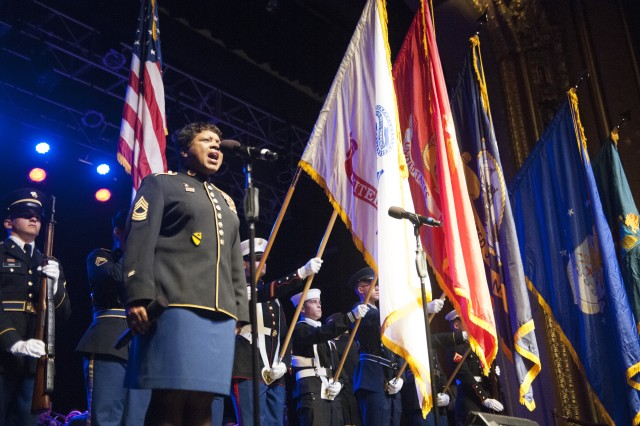 "PRESIDIO OF MONTEREY, Calif. -- Master Sgt. Marva Lewis, U.S. Army ""Jazz Ambassadors"" lead vocalist, sings the national anthem the Defense Language Institute Foreign Language Center volunteer color guard presents the colors before a performance at the Golden West Theater in Monterey, Calif. March 17, 2016.  The U.S. Army Field Band's jazz ensemble played to a packed house at the 1250-seat theater. The city is home to the Monterey Jazz Festival, an event that draws hundreds of artists and thousands of music-lovers to the city each year; and to the Presidio of Monterey, an Army installation located in the heart of the city's downtown."