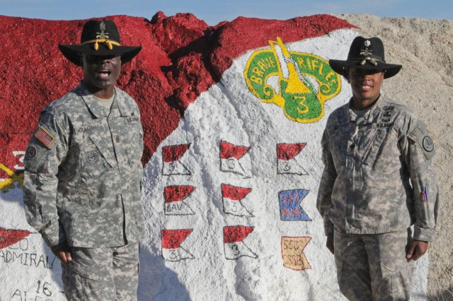 "Lt. Col. Lynn Ray (right), the first commander of Regimental Engineer Squadron ""Pioneer,"" 3rd Cavalry Regiment, poses with Command Sgt. Maj. Rodney Holloway, senior enlisted advisor, at Painted Rock at Fort Irwin, Calif., after 3rd CR's National Training Center rotation earlier this year. (Photo by Staff Sgt. Tomora Clark, 3rd Cav. Regt. Public Affairs NCOIC)"