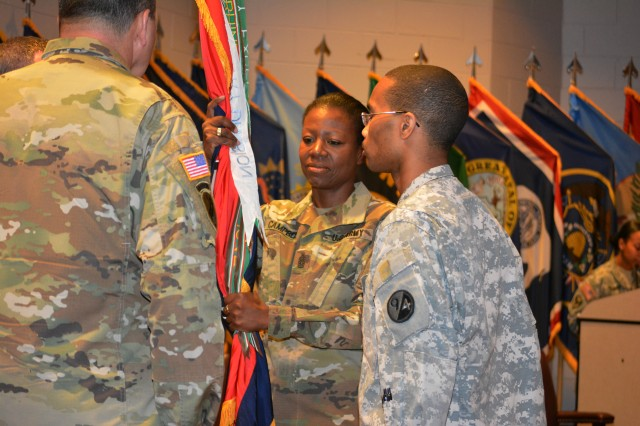 Command Sgt. Maj. Sharon Campbell, accepts the 94th Training Division colors from the commander, Brig. Gen. Steven W. Ainsworth, during a change of responsibility ceremony at Fort Lee, Va., March 18, 2016. By accepting the colors, Campbell became the first female to hold the command sergeant major position. The command sergeant major is the commander's primary advisor and sets the standard across the command for enlisted Soldiers. Campbell will now be responsible for the Soldiers' performance, training, appearance, and conduct. She'll also be providing direction and guidance to more than 35 other command sergeants major assigned to subordinate units.