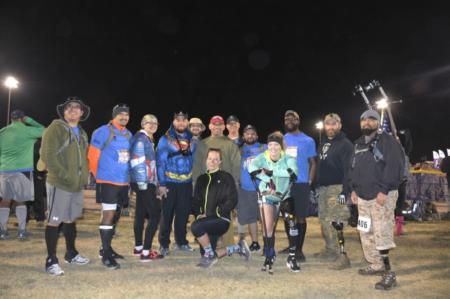 Deputy Assistant Secretary of Defense, Office of Warrior Care Policy, James Rodriguez, center, poses with wounded warriors during the March 20 Bataan Memorial Death March at White Sands Missile Range, N.M. The wounded warriors are with Disabled Sports USA out of the Warfigher Program at Walter Reed National Military Medical Center.