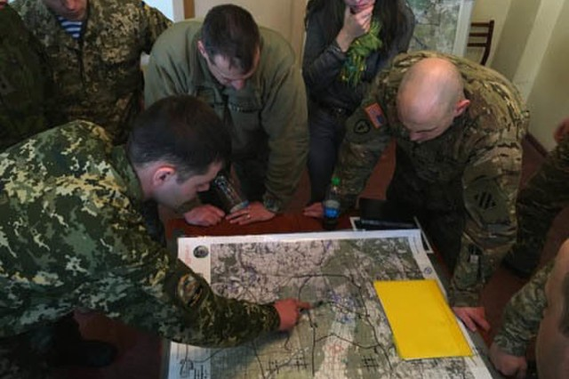 Soldiers with the Ukrainian Land Forces brief U.S. Army Soldiers with 3rd Battalion, 15th Infantry Regiment, 2nd Infantry Brigade Combat Team, 3rd Infantry Division on their company mission course of action March 18, 2016, as part of a military decision-making process practical exercise at the International Peacekeeping and Security Center near Yavoriv, Ukraine. The exercise is a part of Joint Multinational Training Group-Ukraine, the name given to the multinational training effort to assist Ukraine with increasing its capacity for self-defense.