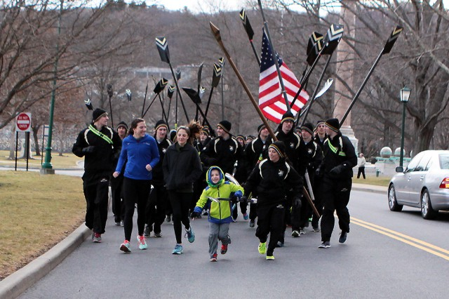 U.S. Military Academy at West Point Class of 2016 Cadet Jordan Duran runs with Joey Carpenter in the 2nd annual Golden Oar run. Joey is the son of Capt. Matthew Carpenter, USMA Class of 2003, who died of cholargiocarcinoma, or cancer of the bile ducts Dec. 1, 2010. The crew team honored their fallen or wounded former crew team members before the start of the spring rowing season Mar. 3 (U.S. Army photo by Kathy Eastwood, USMA West Point Public Affairs/released.)