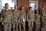 Several 900th Contracting Battalion Soldiers receive medals for their deployment March 9 at Fort Bragg, North Carolina.