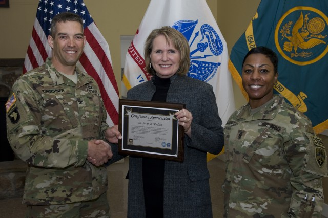Dr. Susan R. Madsen receives a Certificate of Appreciation from Col. Sean Kirschner, U.S. Army Dugway Proving Ground's commander, March 14 at the Community Club. Standing on the other side of Madsen is Command Sgt. Maj. Montonya Boozier. Photo by Al Vogel, Dugway Public Affairs.