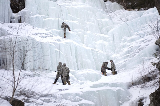 A Soldier with Alpha Company, 3rd Battalion, 172nd Infantry Regiment, 86th Infantry Brigade Combat Team (Mountain), climbs an ice wall at Smugglers' Notch in Jeffersonville, Vt., March 5, 2016.  Soldiers performed basic and advanced mountain warfare skills like ice climbing, mountain movement techniques, and nighttime navigation as part of their mountaineering winter bivouac.