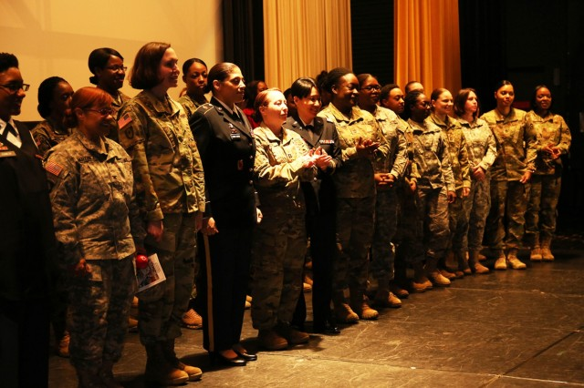 Women are recognized on stage during the Women's History Month Observance held March 17 at Camp Zama's Community Activity Center. (U.S. Army Photo by Noriko Kudo)