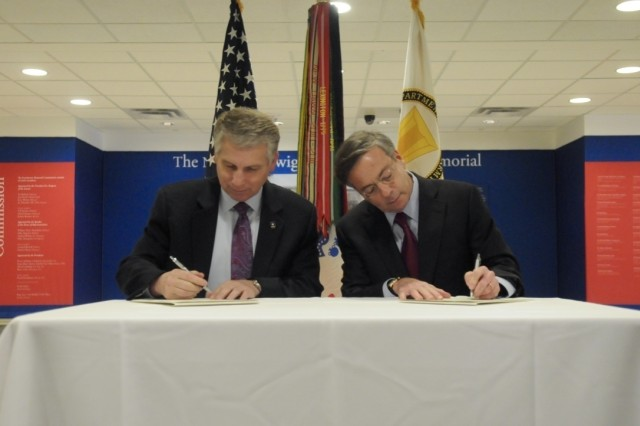 "Stephen Austin, assistant chief of Army Reserve, and Sidney Goodfriend, founder and chairman of American Corporate Partners, sign a partnership agreement between the USAR and ""ACP"" During the American Corporate Partners and USAR Partnership Signing at the Pentagon in Washington March 21."