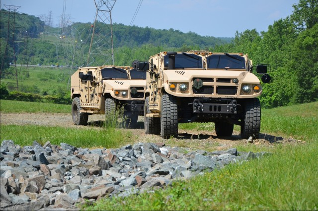 Shown here is the JLTV produced by AM General, one of the JLTV Engineering, Manufacturing, and Development (EMD) Phase vendors.  AM General actively participated in the JLTV ESOH WG to identify and track ESOH hazards.  The collaboration of the ESOH WG and the vendors will result in reduced ESOH risk throughout the program.