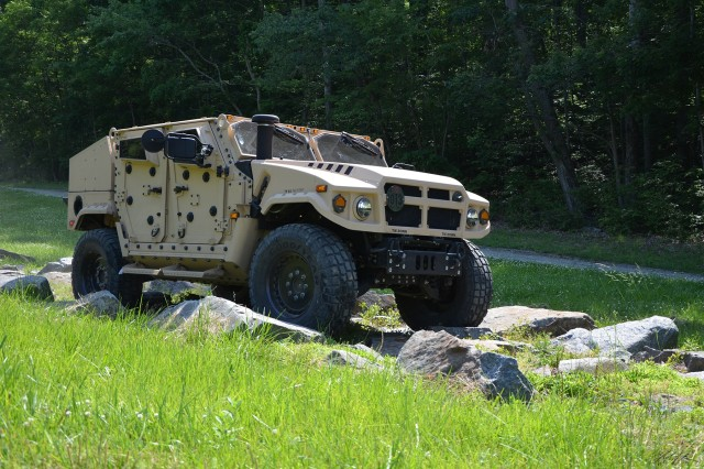 Shown here is the AM General JLTV.  AM General worked with the ESOH WG to support the program's Pollution Prevention initiatives including hazardous materials minimization and improved fuel efficiency.  The P2 efforts will result in reduced environmental risk and liability and improved sustainability.