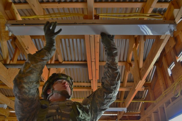A U.S. Army Reserve Soldier with the 389th Engineer Company (Hortizontal), installs new light fixtures during Combat Support Training Exercise 78-16-01 at Fort Hunter Liggett, Calif. Nearly 40 units from the U.S. Army Reserve, U.S. Air Force and Canadian Armed Forces trained at Joint Base McGuire-Dix-Lakehurst, N.J., Fort Knox, Ky. and Fort Hunter Liggett, Calif., as part of the 84th Training Command's CSTX 78-16-01. This exercise marks the first CSTX of 2016 and is hosted by the 78th Training Division. (U.S. Army photo by Sgt. Steffanie Collazo)