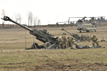 Troopers assigned to Archer Battery, Field Artillery Squadron, 2nd Cavalry Regiment, clear and prepare their unit's M777 Howitzer for a fire mission after having their teams, along with their equipment, transferred from one firing position to another via a CH-47 Chinook helicopter belonging to the 12th Combat Aviation Brigade (Helicopter Detachment) during the unit's sling load operations conducted at the Grafenwoehr Training Area, located near Rose Barracks, Germany, Mar. 23, 2016. (U.S. Army photo by Sgt. William A. Tanner)