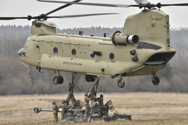Troopers assigned to Archer Battery, Field Artillery Squadron, 2nd Cavalry Regiment, load their unit's M777 Howitzer to be transferred from one firing position to another via a CH-47 Chinook helicopter belonging to the 12th Combat Aviation Brigade (Helicopter Detachment) during the unit's sling load operations conducted at the Grafenwoehr Training Area, located near Rose Barracks, Germany, Mar. 23, 2016. The purpose of this event was to conduct Artillery Table II training while helping to establish working operations between 2CR's Field Artillery Squadron and the 12th CAB. (U.S. Army photo by Sgt. William A. Tanner)