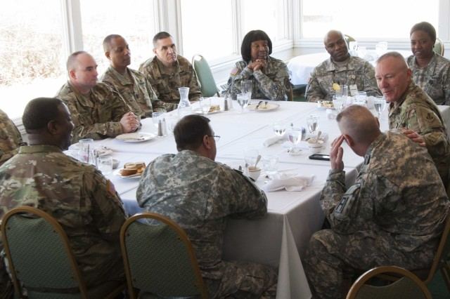 Command Sgt. Maj. Dennis Defreese, commandant, U.S. Army Sergeants Major Academy, discusses his initiatives over lunch with sergeants major at Rock Island Arsenal, Illinois, March 17. (Photo by Kevin Fleming, ASC Public Affairs)