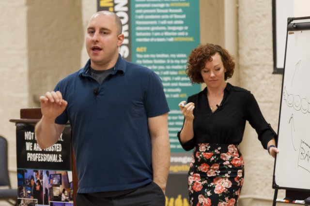 """Courtney Abbott and George Zerante, senior educators from Catharsis Productions, co-instruct a """"Got Your Back Training"""" session for sexual violence prevention in Heritage Hall at Rock Island Arsenal, March 23. (Photo by Kevin Fleming, ASC Public Affairs)."""