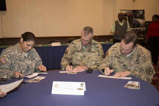 Maj. Gen. James F. Pasquarette, commanding general of USARJ, Col. William B. Johnson and Command Sgt. Maj. Rosalba Dumont-Carrion, commander and command sergeant major of USAG Japan, respectively, fill out AER contribution forms during the 2016 AER 2016 kickoff held March 18 at Camp Zama's Community Club. (U.S. Army photo by Alia Naffouj)
