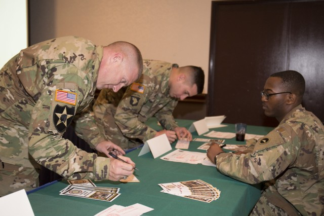Soldiers fill out AER contribution forms during the 2016 AER 2016 kickoff held March 18 at Camp Zama's Community Club. (U.S. Army photo by Alia Naffouj)