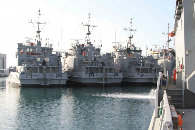 Landing Craft Utility boats sit in dock at the Kuwait Naval Base as part of APS-5 Kuwait, an army prepositioned wartime stocks program. APS-5 maintains over 30 Army watercraft in ready-for-issue condition as part of Army Central's contingency operations strategy.