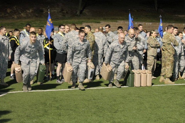U.S. Air Force Airmen with the 18th Weather Squadron, carry water jugs during the second-ever Talon Challenge competition, at Fort Bragg's Towle Stadium, Mar. 24. The 3rd General Support Aviation Battalion of the 82nd Combat Aviation Brigade hosted the physical fitness competition.