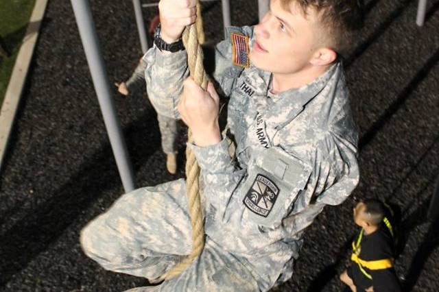 Reserve Officer Training Corps cadet climbs a rope. Cadets from Fayetteville State and Duke Universities participated during the second-ever Talon Challenge competition, at Fort Bragg's Towle Stadium, Mar. 24. The 3rd General Support Aviation Battalion of the 82nd Combat Aviation Brigade hosted the physical fitness competition.