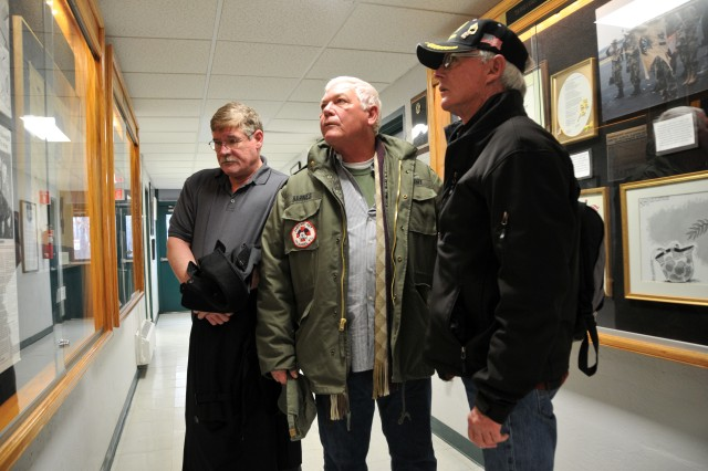 Former Army Reserve Soldiers Michael O'Toole, Russell Barnes and Russell Dearing, from left, review the Greensburg Army Reserve Center's artifacts related to the Feb. 21, 1991 Scud missile attack against Dhahran, Saudi Arabia that killed 13 and wounded 43 Soldiers of the Army Reserve's 14th Quartermaster Detachment. The trio carried out medevac and other life-saving missions in the immediate aftermath of that single-most devastating attack against allied forces during the Gulf War.