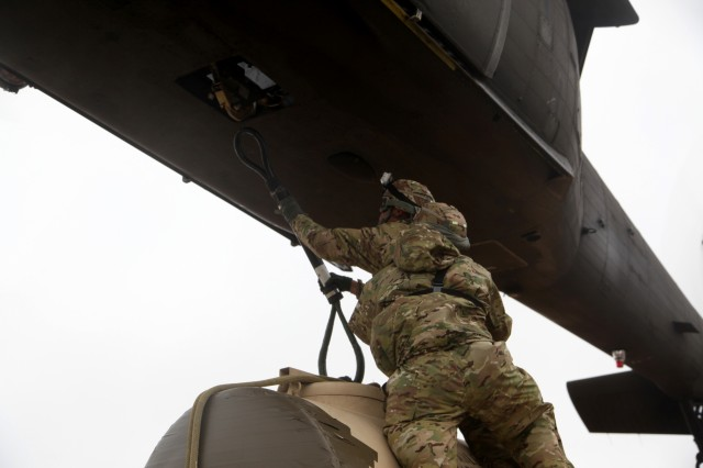 Soldiers from the 3rd Military Information Support Battalion conduct operations to sling-load an M-149 Water trailer with a UH-60 Black Hawk helicopter during civil support training at Camp Butner, N.C., March 20. The training was based on a civil authority information support mission during which 3rd MISB supported other federal entities in gathering and disseminating lifesaving information during a simulated natural disaster.