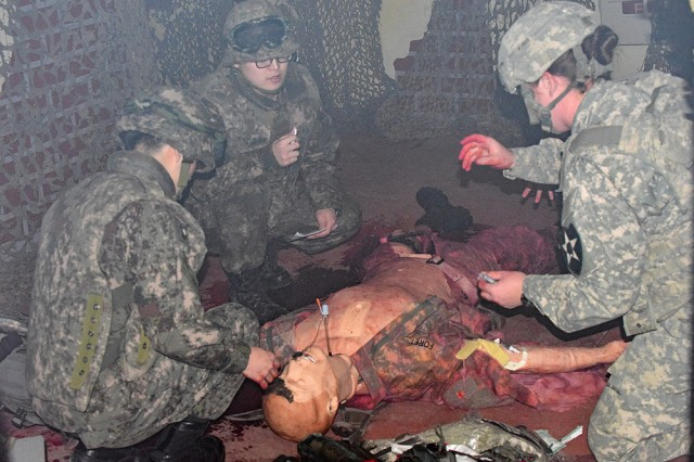 Female Soldiers from the 1-2 Stryker Brigade Combat Team work alongside male Soldiers from the Republic of Korea 16th Mechanized Infantry Brigade during a simulated combat medical training exercise in a smoke-filled training facility March 15 at the Rodriguez Live Fire Complex near Pocheon, South Korea. With the recent decision to open all combat related positions to every Service Member who qualifies, front-line training like this will be extremely important. (Photo by Tim Oberle, Eighth Army Public Affairs)