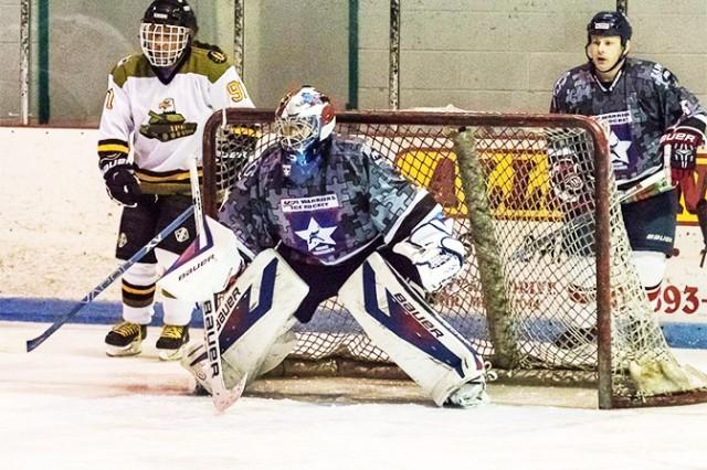 John M. Laursen plays goalie for the USA Warriors hockey team.