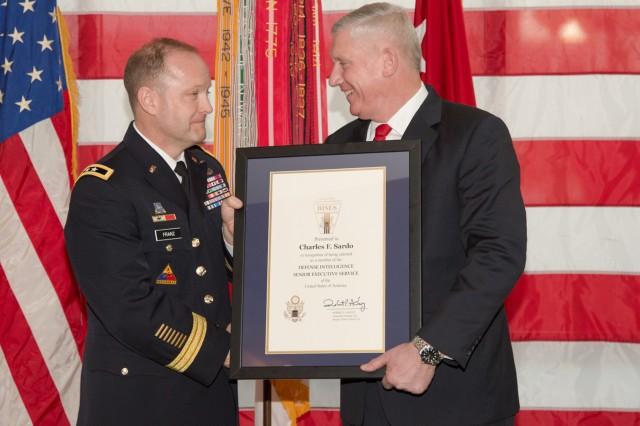 Charles F. Sardo, chief of staff, U.S. Army Intelligence and Security Command (INSCOM), accepts a certificate in recognition of being selected as a member of the Defense Intelligence Senior Executive Service from Maj. Gen. George J. Franz III, INSCOM commanding general, at Fort Belvoir's Nolan Building, March 21.