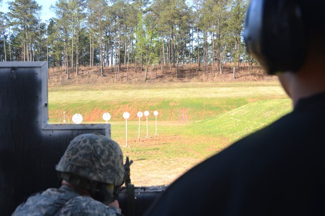 "A Soldier fires at steel targets during the multi-gun event March 19 during the 2016 U.S. Army Small Arms ""All Army"" Championship, hosted by the U.S. Army Marksmanship Unit. In some stages, soldiers transitioned from rifle to pistol and, in others, they shot various moving and fixed targets at different distances."