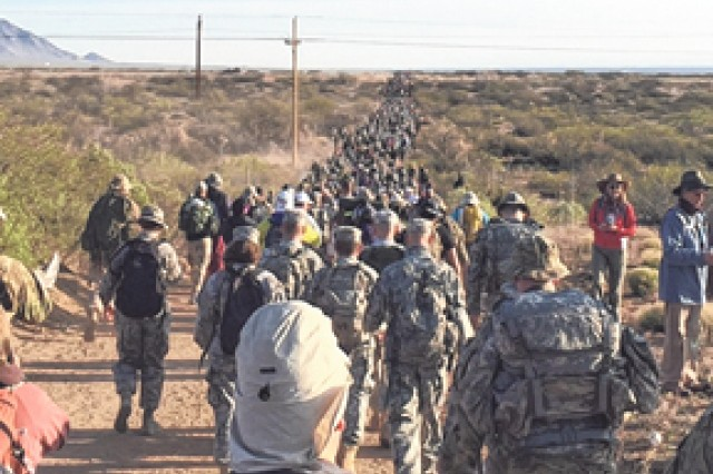 Soldiers representing Fort Leonard Wood join participants in the 27th Bataan Memorial Death March at White Sands Missile Range, New Mexico.