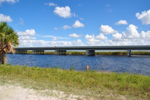 The Tamiami Trail One-Mile Bridge was completed in December 2013. The bridge was constructed as part of the Modified Water Deliveries to Everglades National Park Project and will enable additional water to flow into Everglades National Park.