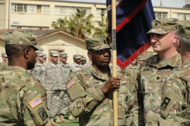 Lt. Col. Blaine White (third from left) prepares to accept the guidon of the CONUS Replacement Center during a Relief in Place/Transfer of Authority ceremony at Fort Bliss, Texas.