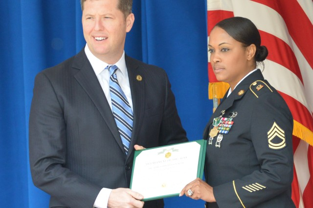 Acting Secretary of the Army Patrick Murphy recognizes Sgt. 1st Class Raquel R. Mendoza of the 4th Sustainment Brigade, 4th Infantry Division, as the Army Sexual Assault Response Coordinator of the Year during a ceremony at the Pentagon, March 31, 2016.