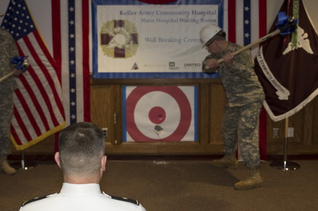 Col. Brian S. Burlingame, Commander, West Point Health Service Area, strikes the wall ceremonially kicking off the Keller Army Community Hospital Modernization Project, Thursday, at West Point, N.Y.