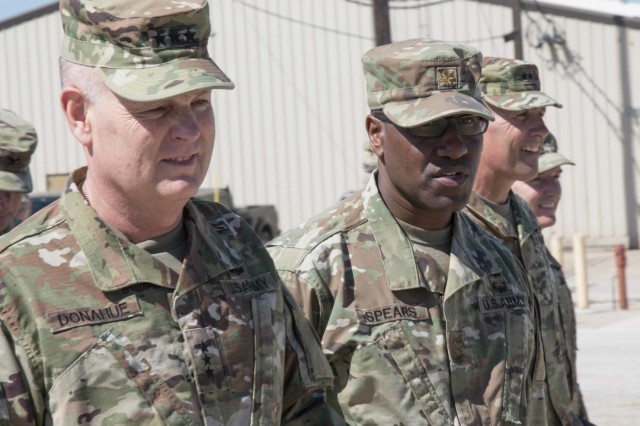 "Maj. Michael Spears, the 3rd Armored Brigade Combat Team ""Greywolf,"" 1st Cavalry Division S-4, shows Lt. Gen. Patrick Donahue, the deputy commanding general of U.S. Army Forces Command, around the III Corps motor pool to give him an upclose view of the brigade efforts to redistribute excesss equipment. The Greywolf Brigade is spearheading an Army-wide effort to do away with excess, obsolete and unserviceable equipment. This effort will establish the process that the rest of the Army will use to turn-in or laterally transfer equipment."
