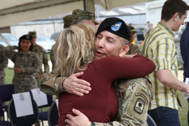 Col. Miguel Castellanos, outgoing commander of the 361st Civil Affairs Brigade, hugs Stacey Novak, wife of the incoming commander Col. John Novak after the 361st change of command ceremony Sunday, April 3, 2016 at Daenner Kaserne in Kaiserslautern, Germany. (Photo by Lt. Col. Jefferson Wolfe, 7th Mission Support Command Public Affairs Officer)