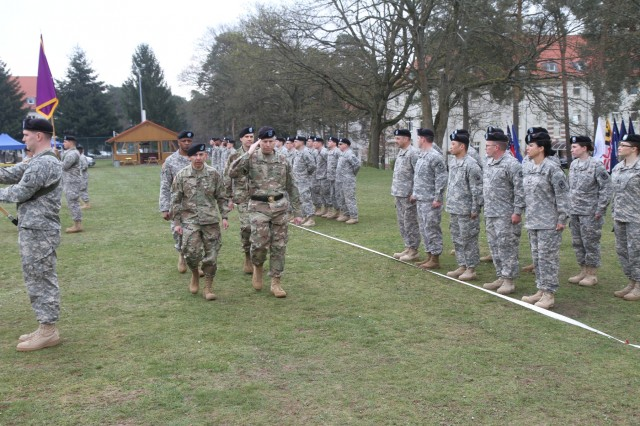 Brig. Gen. Arlan DeBlieck, commanding general of the 7th Mission Support Command (saluting), Col. Miguel Castellanos, outgoing commander of the 361st Civil Affairs Brigade, (left, front) and Col. John Novak, incoming commander of the 361st Civil Affairs Brigade (back, right) walk the line of troops during the 361st change of command ceremony Sunday, April 3, 2016 at Daenner Kaserne in Kaiserslautern, Germany. Lt. Col. Wayne Mingo, executive officer for the 361st accompanies them. (Photo by Lt. Col. Jefferson Wolfe, 7th Mission Support Command Public Affairs Officer)