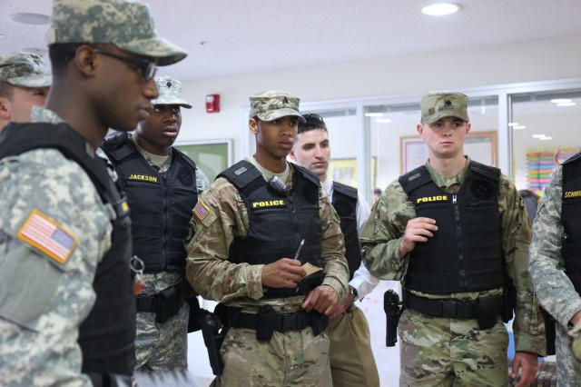 Soldiers assigned to the 88th MPD participate in an after action report for the active shooter and evacuation exercise held March 31 at Arnn Elementary School. (U.S. Army Photos by Noriko Kudo)