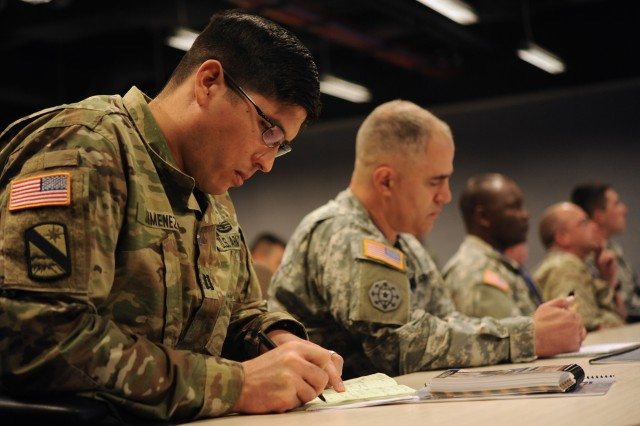 A participant of the Operational Contract Support Joint Exercise 2016 takes notes during an OCS academics course, March 31, 2016, at Fort Bliss, Texas. Over 500 joint, interagency and multinational participants are developing tools and confidence to support any deployed contingency operation or natural disaster.