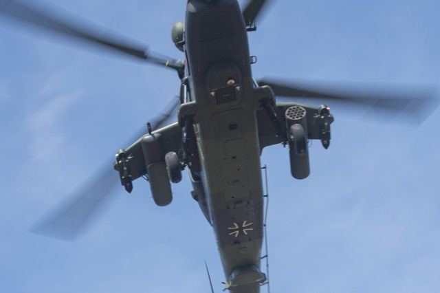 A German Tiger attack helicopter from 4th Battalion, Kampfhubschrauberregiment 36, Fritzlar, Germany, flys above the forward arming and refueling point (FARP) en-route to engage targets on a live-fire range. The 1st Bn., 3rd Avn. Regt., recently completed their combined combat aerial gunnery from March 16-April 05, at the Grafenwoehr Training Area, Germany. (U.S. Army photo by Sgt. Thomas Mort, 12th CAB)