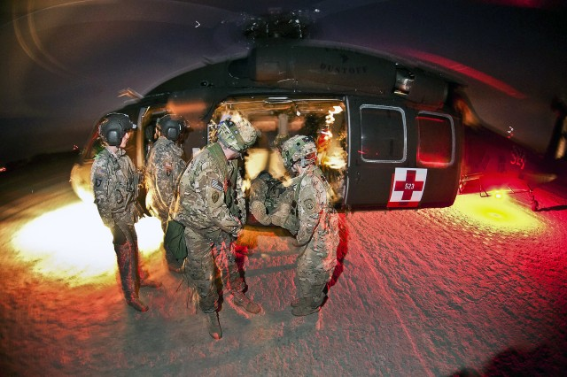 Medics with the 82nd Airborne Division's 1st Brigade Combat Team, retrieve notionally wounded paratroopers from a Black Hawk medevac helicopter operated by the 101st Airborne Division's 159th Brigade, Jan. 23, 2012, at the Joint Readiness Training Center, Fort Polk, La.
