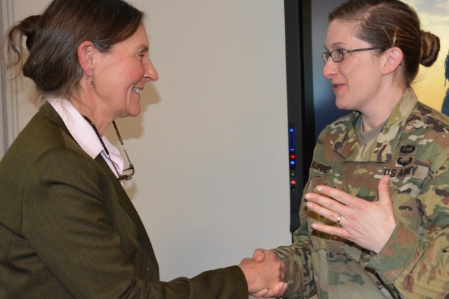 At right, Lt. Col. Alicia Surrey talks to retired Brig. Gen. Rhonda Cornum following the former prisoner of war's speech about resilience during Intrepid Spirit's open house, March 24, during Brain Injury Awareness Month. Surrey, battalion commander for the medical center's troop command, said Cornum's message was powerful and gives people hope that they can survive adversity and still be successful.