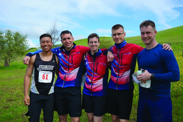 Capt. Jordan Laughlin, second from left, joins fellow U.S. Armed Forces representatives at the 2016 Orienteering Championship in March. Pictured with him are 1st Lt. Ted Fong, 1st Lt. Hannah Culberg, Capt. Kevin Culberg and 1st Lt. Zach Hoeffner. Hoeffner is the sole U.S. Air Force Academy graduate pictured among West Point alumni.